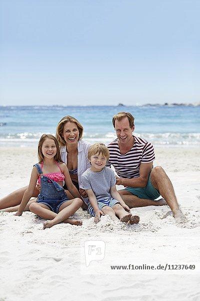 Family sitting on beach