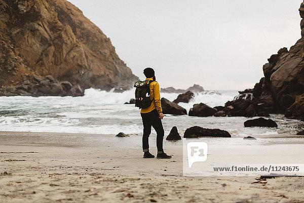 Hiker enjoying view on beach  Big Sur  California  USA