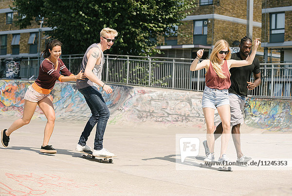 For adult friends learning to skateboard in skatepark