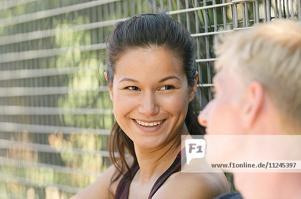 Couple talking by wire fence