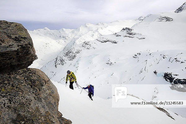 Mountaineers ascending snow-covered mountain  Saas Fee  Switzerland