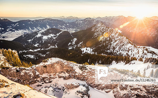 Snow-covered mountain landscape at sunrise  Teufelstattkopf mountain  Oberammergau  Bavaria  Germany