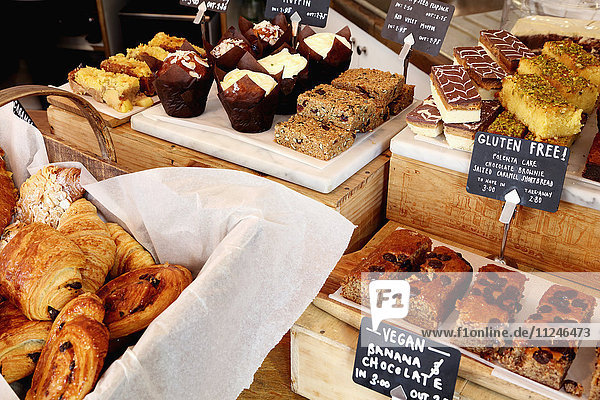 Independent coffee shop with display of vegan and gluten-free cakes