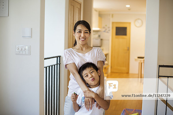 Family home. A woman and a young girl at home.