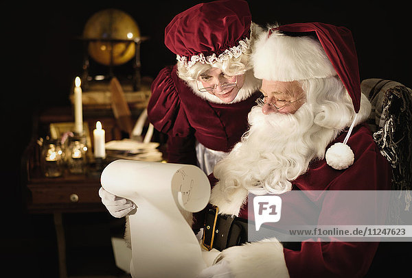 Santa and Mrs. Claus reading child's letter