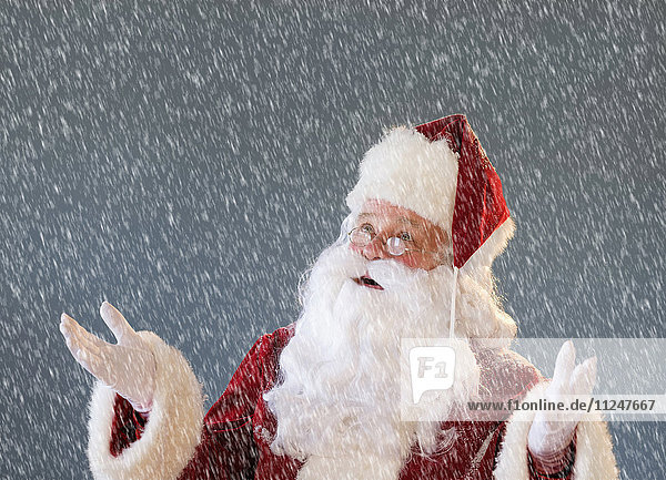 Portrait of Santa Claus looking up and gesturing