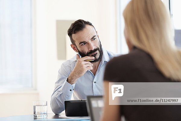 Man and woman sitting in office