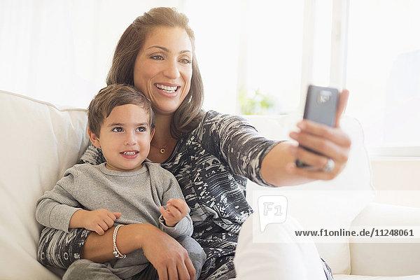 Mother taking selfie son (2-3)