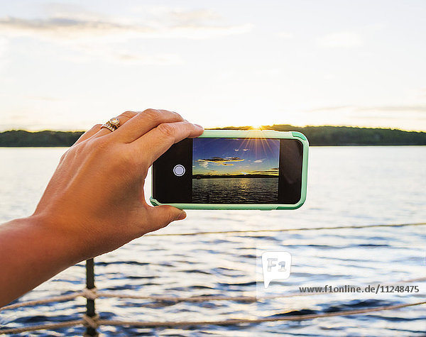 Woman taking picture with smartphone