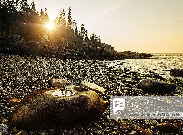 Rocks and pebbles on beach at sunrise Rocks and pebbles on beach at sunrise