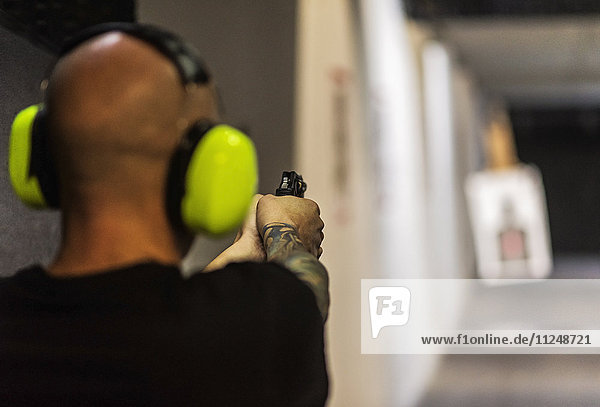 Man shooting gun at shooting range Man shooting gun at shooting range