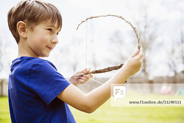 Portrait of boy (6-7) with toy bow