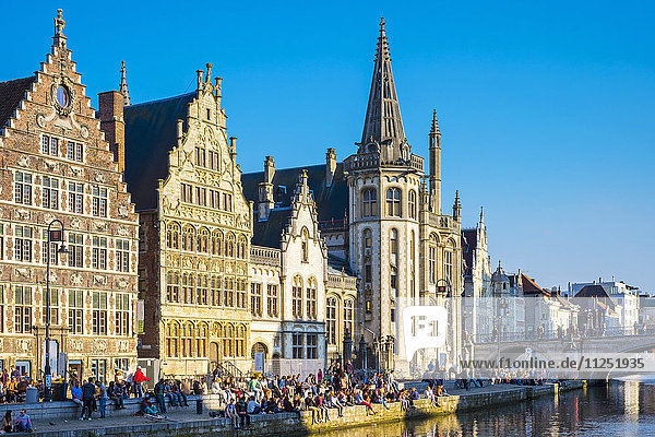 Belgium,  Flanders,  Ghent (Gent). Medieval guild houses on Graslei and the Leie River.