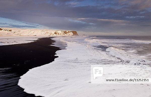 Waves breaking on Reynisfjara black beach Vik southern Iceland Europe