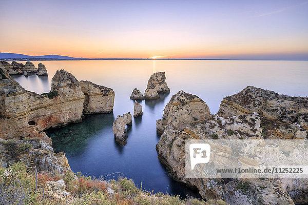 Soft colors of dawn on the cliffs of Ponta da Piedade Lagos Algarve Portugal Europe