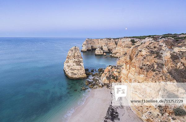 Top view of cliffs and turquoise water of the ocean Praia da Marinha Caramujeira Lagoa Municipality Algarve Portugal Europe