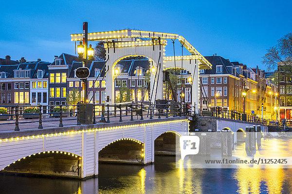 Netherlands  North Holland  Amsterdam. Magere Brug  Skinny Bridge  on the Amstel River at night.