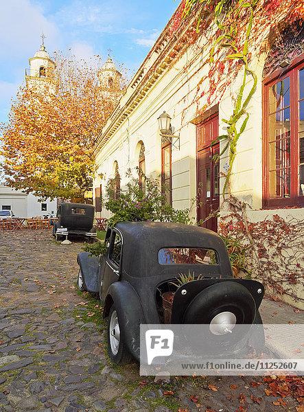 Uruguay  Colonia Department  Colonia del Sacramento  Vintage cars on the cobblestone lane of the historic quarter.