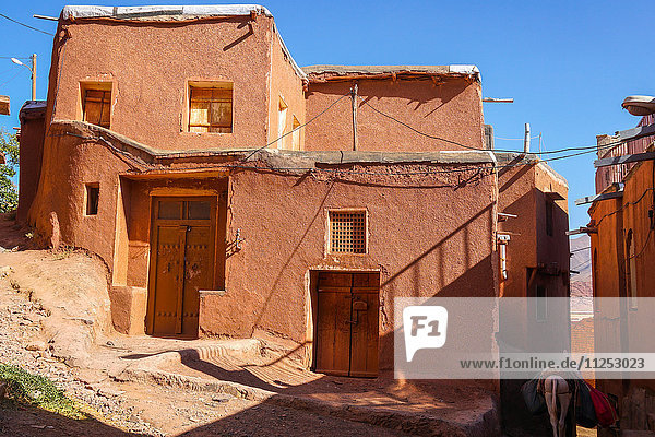 Winding lanes and donkey in 1500 year old traditional village of red mud brick houses  Abyaneh  Iran  Middle East