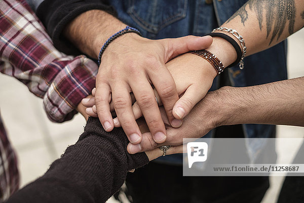 Stack of hands  friends holding hands outdoors