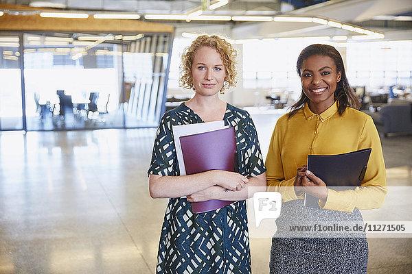 Portrait smiling businesswomen in office
