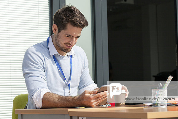 Young businessman in office using digital tablet