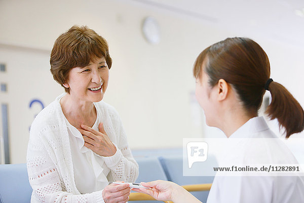 Japanese nurse with patient