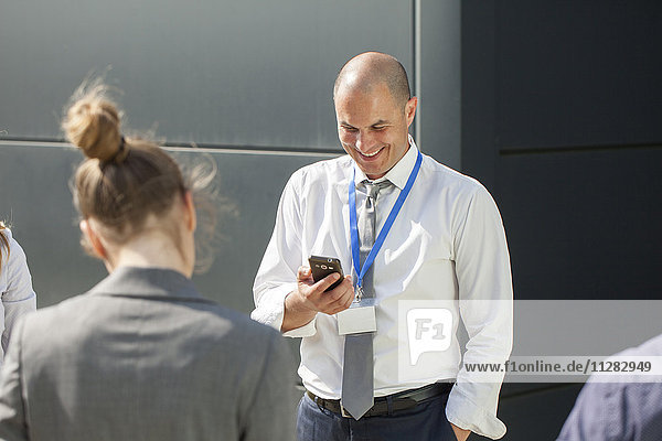 Businessman receiving good news on smartphone
