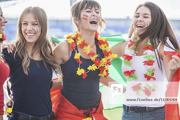 Female soccer fans with different national flags