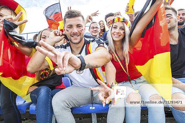 German soccer fans in stadium cheering