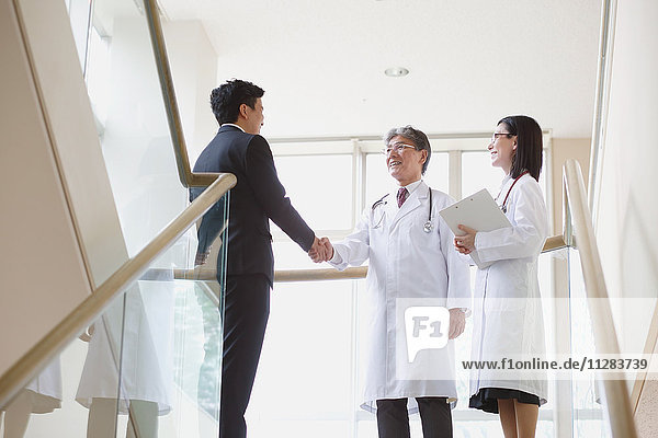 Japanese doctors talking with salesman