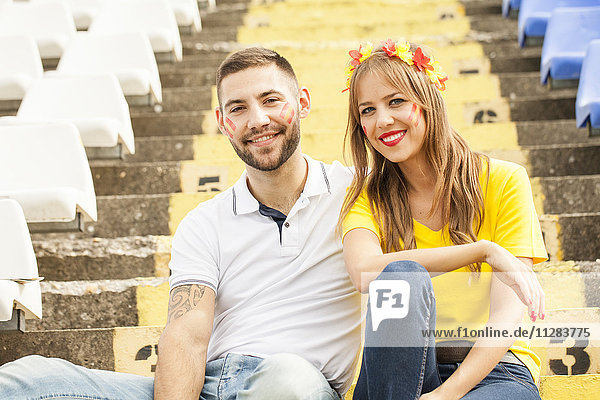 Portrait of young couple in stadium
