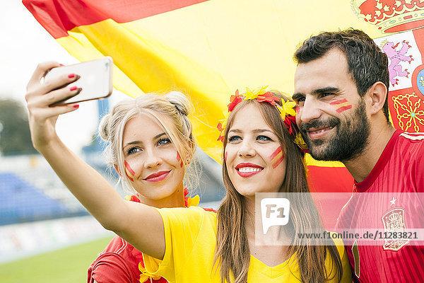 Spanish soccer fans taking a selfie