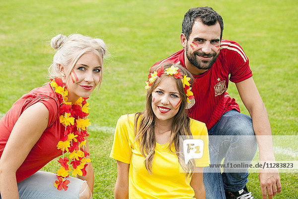 Spanish soccer friends with face paint and floral garland