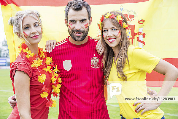 Portrait of Spanish soccer fans with face paint