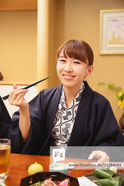 Young Japanese woman wearing yukata at traditional ryokan inn