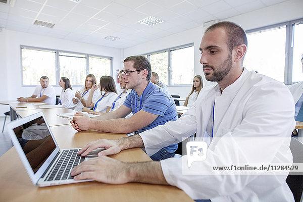 Man using laptop in training class