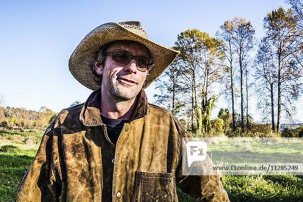 Caucasian farmer wearing cowboy hat outdoors