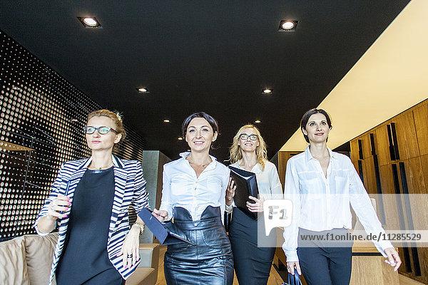 Group of businesswomen walking in lobby