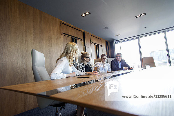 Business people having a meeting in board room