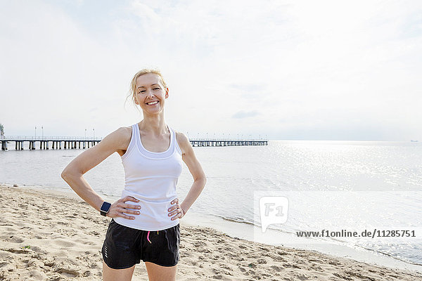 Woman in sports clothing on beach
