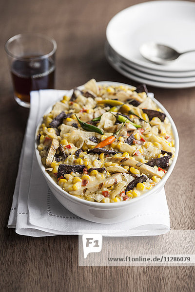 Bowl of Mexican tortilla casserole with corn
