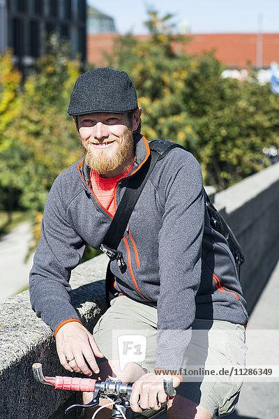 Bike messenger taking a break