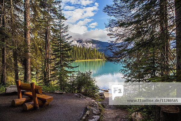 Wooden bench at mountain lake