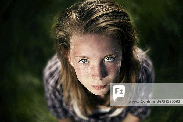 Serious Caucasian girl looking up
