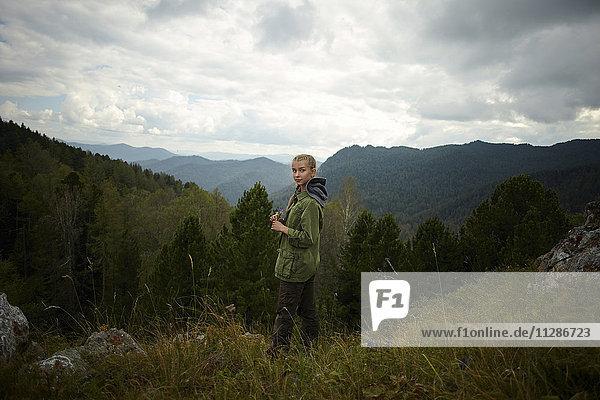 Portrait of Caucasian girl standing on mountain range Portrait of Caucasian girl standing on mountain range