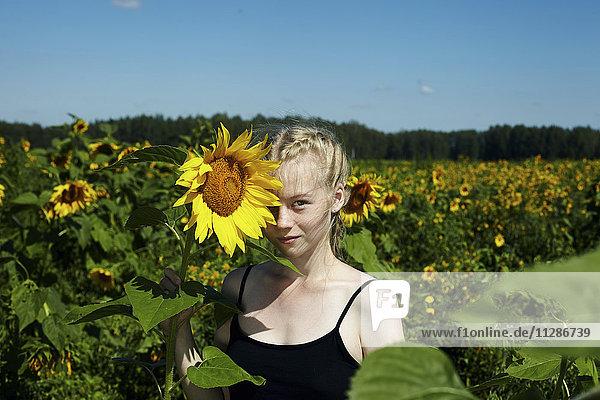 Caucasian girl holding sunflower Caucasian girl holding sunflower