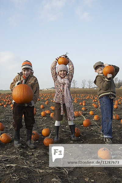 Boy and Girl in Pumpkin Patch