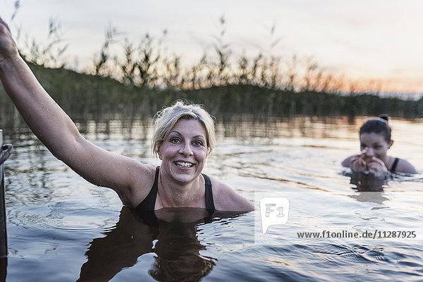 Women swimming in lake