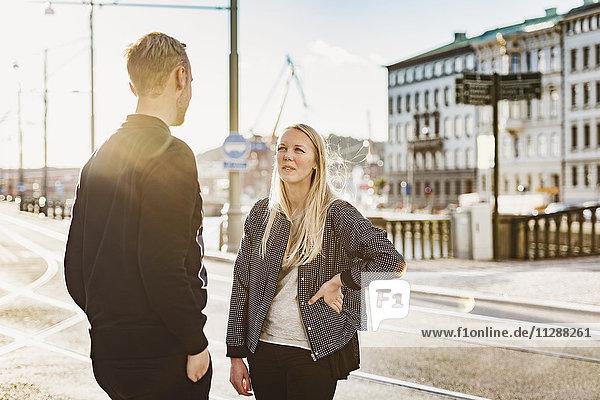 Friends talking on street
